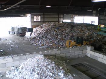 Piles of shredded recycling material in a plant